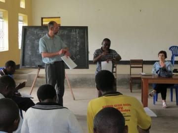 Dr. Howard Robson training Ugandan leaders in TFT